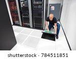 technician lifting floor tile... | Shutterstock . vector #784511851