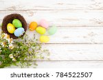 colorful easter eggs in nest... | Shutterstock . vector #784522507