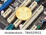 cryptocurrency golden bitcoin... | Shutterstock . vector #784525921