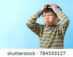 cute little asian boy feel... | Shutterstock . vector #784533127