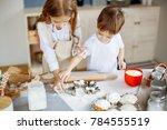 kids cooking baking cookies... | Shutterstock . vector #784555519