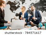 young businesscouple choosing a ...   Shutterstock . vector #784571617
