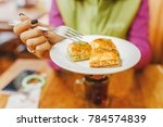 woman eating turkish baklava...   Shutterstock . vector #784574839