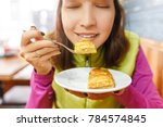 woman eating turkish baklava... | Shutterstock . vector #784574845