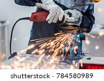 worker cutting metal with angle ... | Shutterstock . vector #784580989
