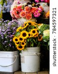 Small photo of Flowers in buckets for sale at a flower vendor stall in Pike Place Market