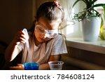 little girl experimenting in... | Shutterstock . vector #784608124