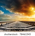 railway to horizon under dramatic sky - stock photo