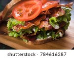 blt sandwich with fried bacon ... | Shutterstock . vector #784616287