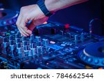 dj plays mix on controller at a ... | Shutterstock . vector #784662544
