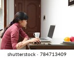 the woman using computer | Shutterstock . vector #784713409