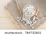 white bean in wood cup on sack... | Shutterstock . vector #784732831