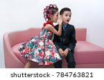 the girl with hair curlers... | Shutterstock . vector #784763821