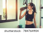 asian young woman drinking... | Shutterstock . vector #784764904
