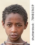 Small photo of Debark, Ethiopia – December 10, 2010: Child in the Simien Mountains that is herding goats at high altitudes