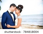 bride and groom on beach | Shutterstock . vector #784818004