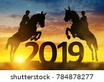 silhouette the riders on the... | Shutterstock . vector #784878277