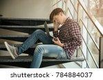 upset teenage boy with laptop... | Shutterstock . vector #784884037