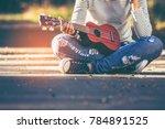 asian teen girl wearing jeans... | Shutterstock . vector #784891525