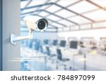modern cctv camera on a wall. a ... | Shutterstock . vector #784897099