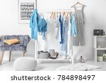 Stock photo collection of clothes hanging on rack in dressing room 784898497