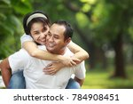 happy young couple together... | Shutterstock . vector #784908451