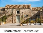 typical houses in the small... | Shutterstock . vector #784925359