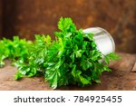 parsley sprigs in a silver... | Shutterstock . vector #784925455