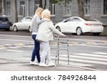 young woman helping her elderly ... | Shutterstock . vector #784926844