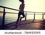 sporty fitness female runner... | Shutterstock . vector #784935595