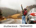 happy tourist travelling in... | Shutterstock . vector #784944955