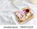 wooden tray with breakfast and... | Shutterstock . vector #784971229
