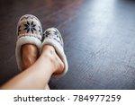 slippers on women's legs. soft...   Shutterstock . vector #784977259