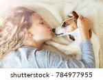 happy child with dog. portrait... | Shutterstock . vector #784977955