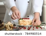 chef decorating piece of tasty... | Shutterstock . vector #784980514