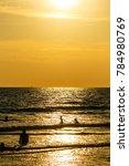 sandy beach  golden sea  sunset | Shutterstock . vector #784980769
