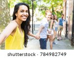 group of friends holding hands... | Shutterstock . vector #784982749