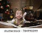 a small child is sitting with a ... | Shutterstock . vector #784990399