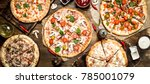 varied pizzas with sauce. on a... | Shutterstock . vector #785001079