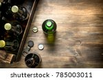 box of fresh beer. on a wooden... | Shutterstock . vector #785003011