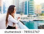 pretty young woman looking from ... | Shutterstock . vector #785012767