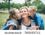 grandmother playing in the park ... | Shutterstock . vector #785035711