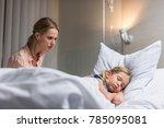 worried mother looking at sick... | Shutterstock . vector #785095081