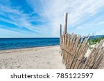 Wooden Palisade On The Sand In...