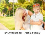 young boy looking to the camera ... | Shutterstock . vector #785154589