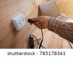 men's hands are plug in power... | Shutterstock . vector #785178361