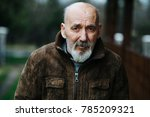 senior man in leather coat | Shutterstock . vector #785209321