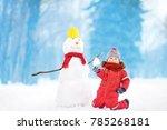 little boy in red winter... | Shutterstock . vector #785268181