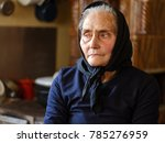 old peasant woman in her house | Shutterstock . vector #785276959