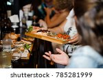 waitress hands holding a big... | Shutterstock . vector #785281999
